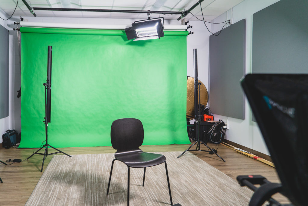 Production studio at Enable Education with green screen and teleprompter