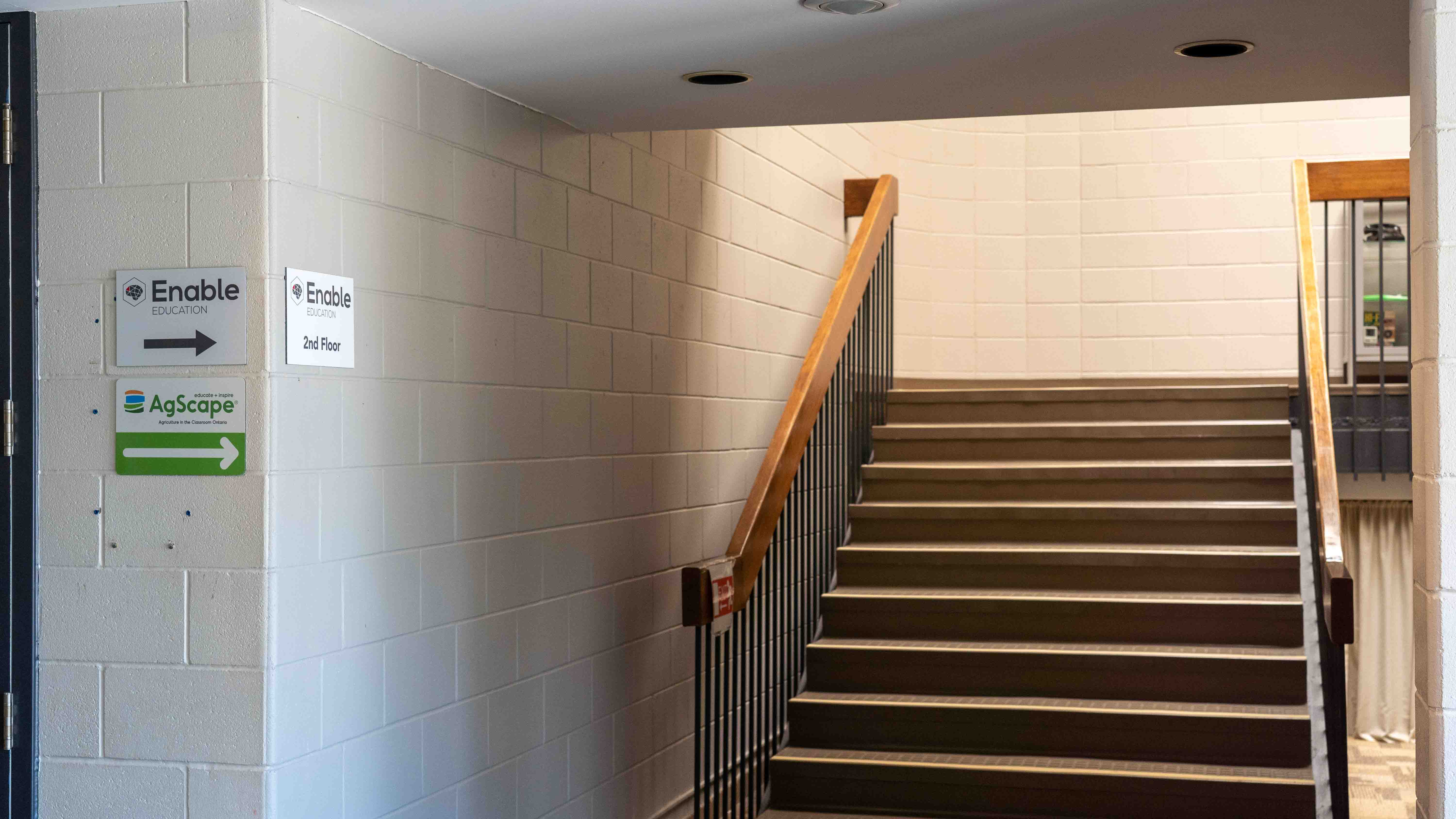 Stairwell leading up to Enable Education